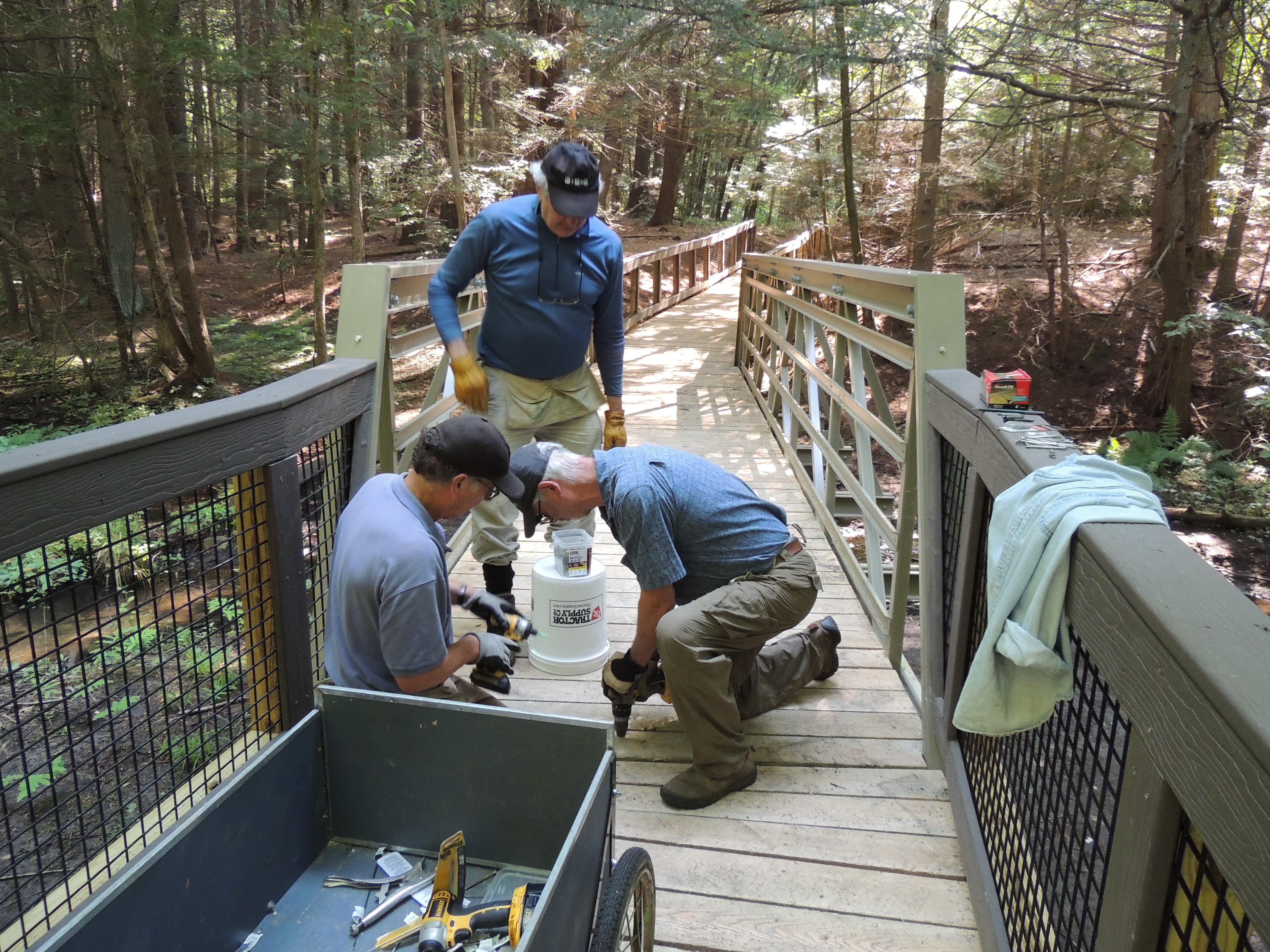 Dick O'Brien And Volunteers Install A New Bridge At Fitzgerald Lake.